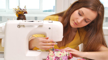 Woman seamstress work on the sewing-mach