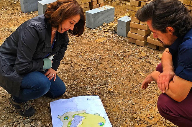 Pippa discussing design plan on site with a contractor