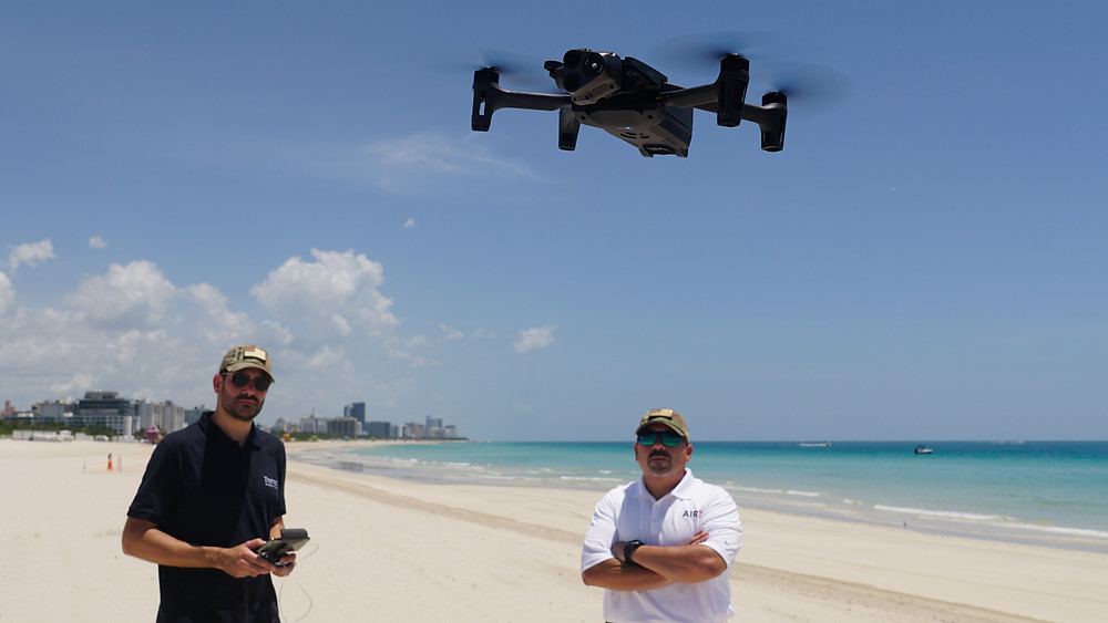 MIAMI BEACH - Parrot's Francois-Xavier Charbonnel demonstrates the new Parrot ANAFI USA to Tony Loperfido of the Airborne International Response Team (AIRT) over a closed Miami Beach on July 3, 2020.  Photo by AIRT.