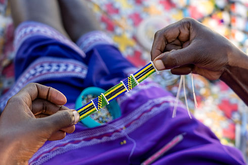 Making of handmade jewellery. Masai afri