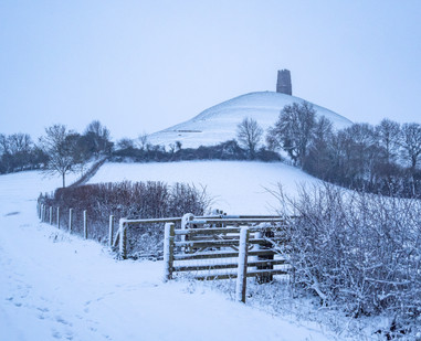 A very snowy Tor before sunrise.