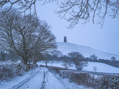 Snow covered road to Glastonbury Tor