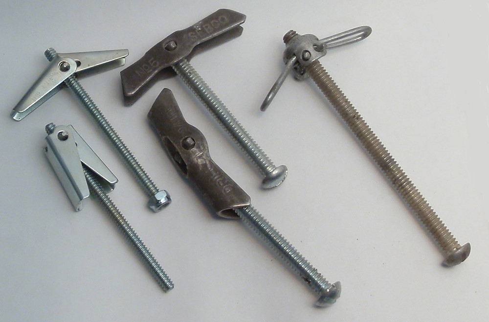Multiple toggle bolts, also known as toggle anchors.
