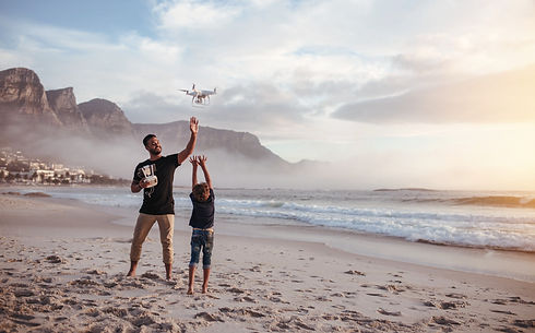 Father and Son Flying a Drone_edited.jpg