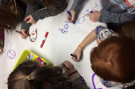 Children drawing at Saint Thomas d'Aquin