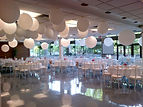 University of Manitoba's Marshall McLuhan hall with fun paper balls hanging from the ceiling for a wedding reception.