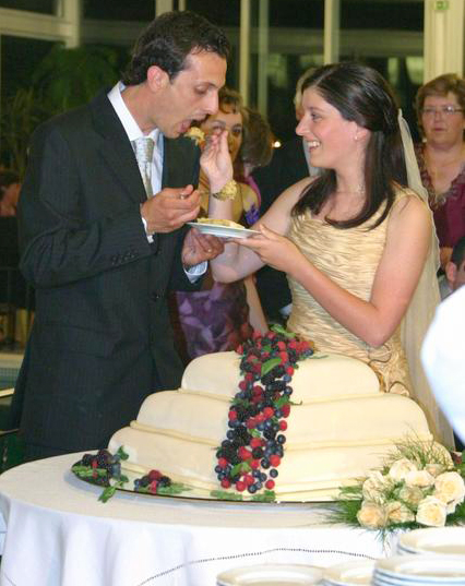 Cake cutting at a wedding reception