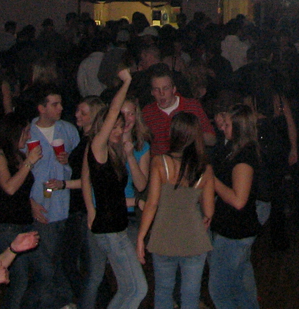 Party-goers dancing at a social