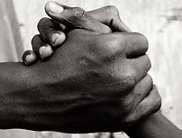 Clasped Africa hands symbolize non-tribal affiliations
