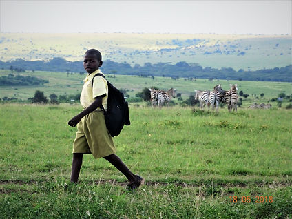 Maasai children in Kitegela have t alk many miles to chool each day
