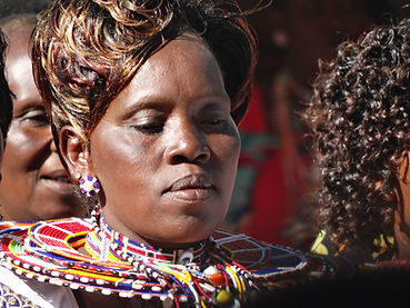 Kitegela Maasai women live traditionl lives enhanced by modern beauty, such as a wig insead of a shaved head