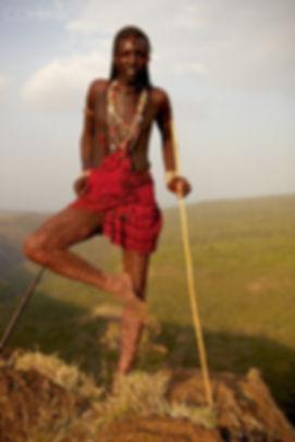 Typical reaasai foot on knee.jpgaxed stance of Maasai warrior