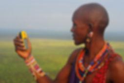 A Maasai woman learns how to use GPS