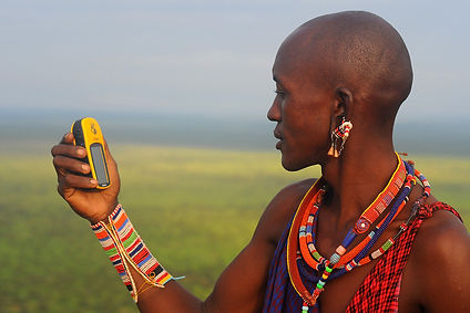 A Maasai woman learns how to use GPS