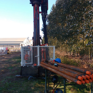 Rig with drilling rods ready to go..jpg