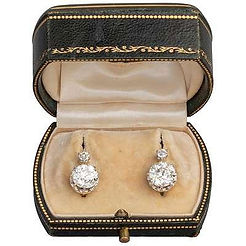 A pair of antique diamond earrings available to purchase online