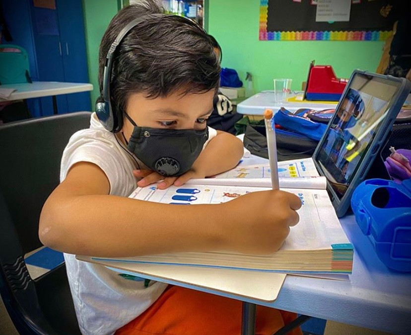 NVCS student with headphones on and in a virtual class session.