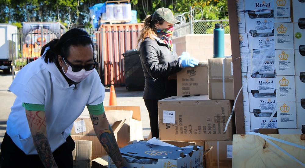 Two volunteers unpacking boxes