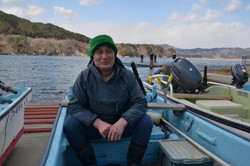 yamada oyster fishermen sits in boat interview.JPG