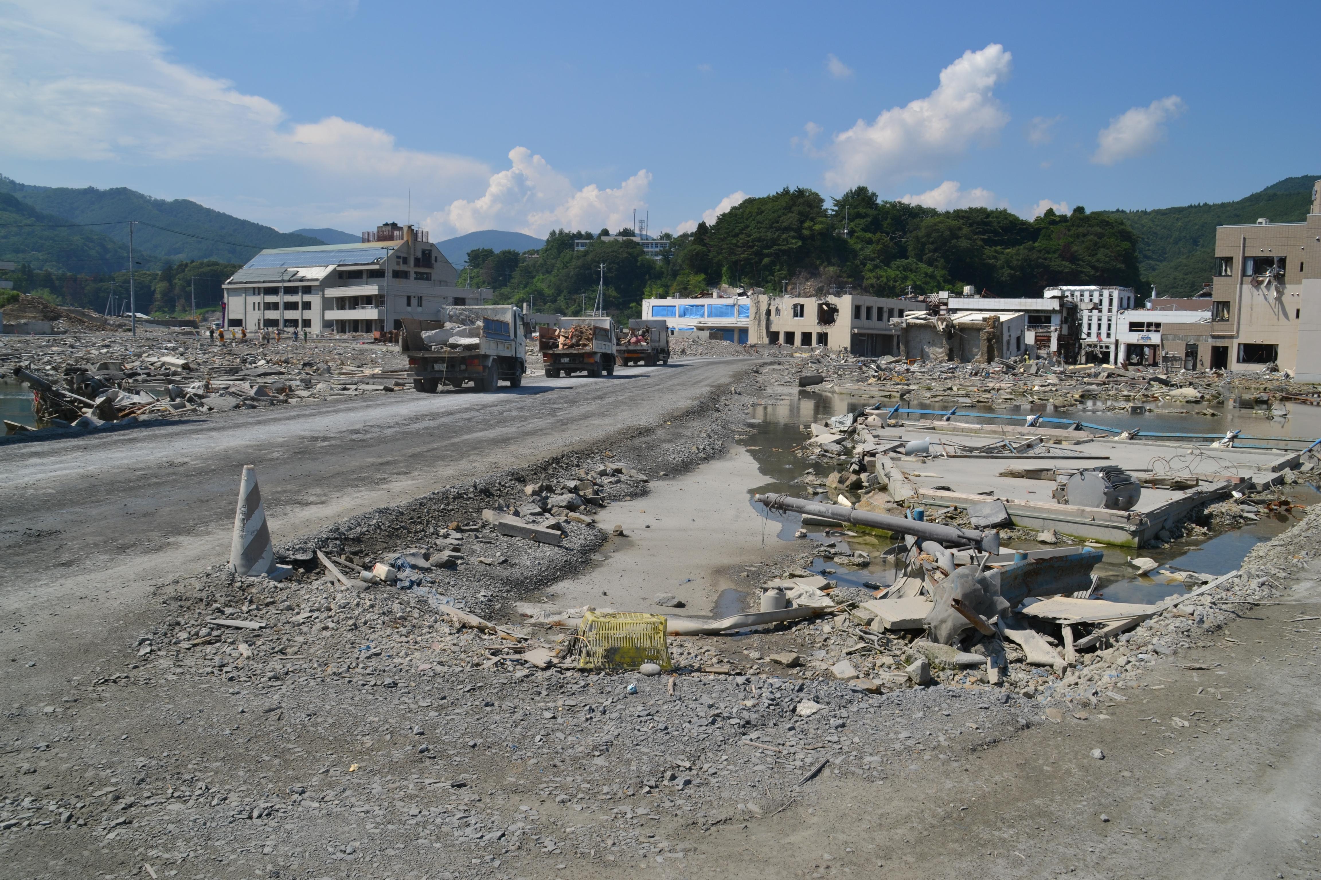 onagawa rubble town center dump trucks.JPG