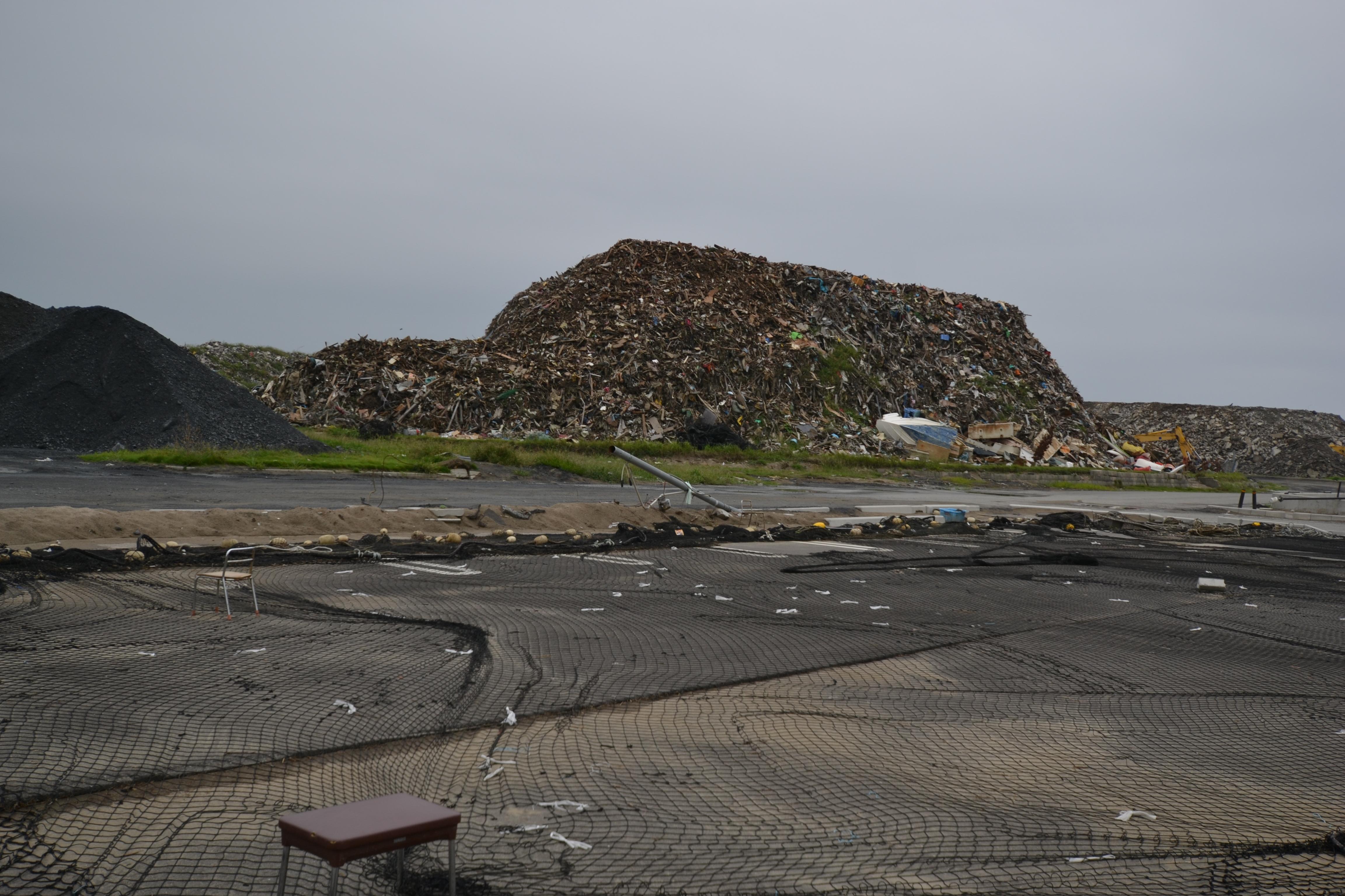watari mountain of debris and nets.JPG