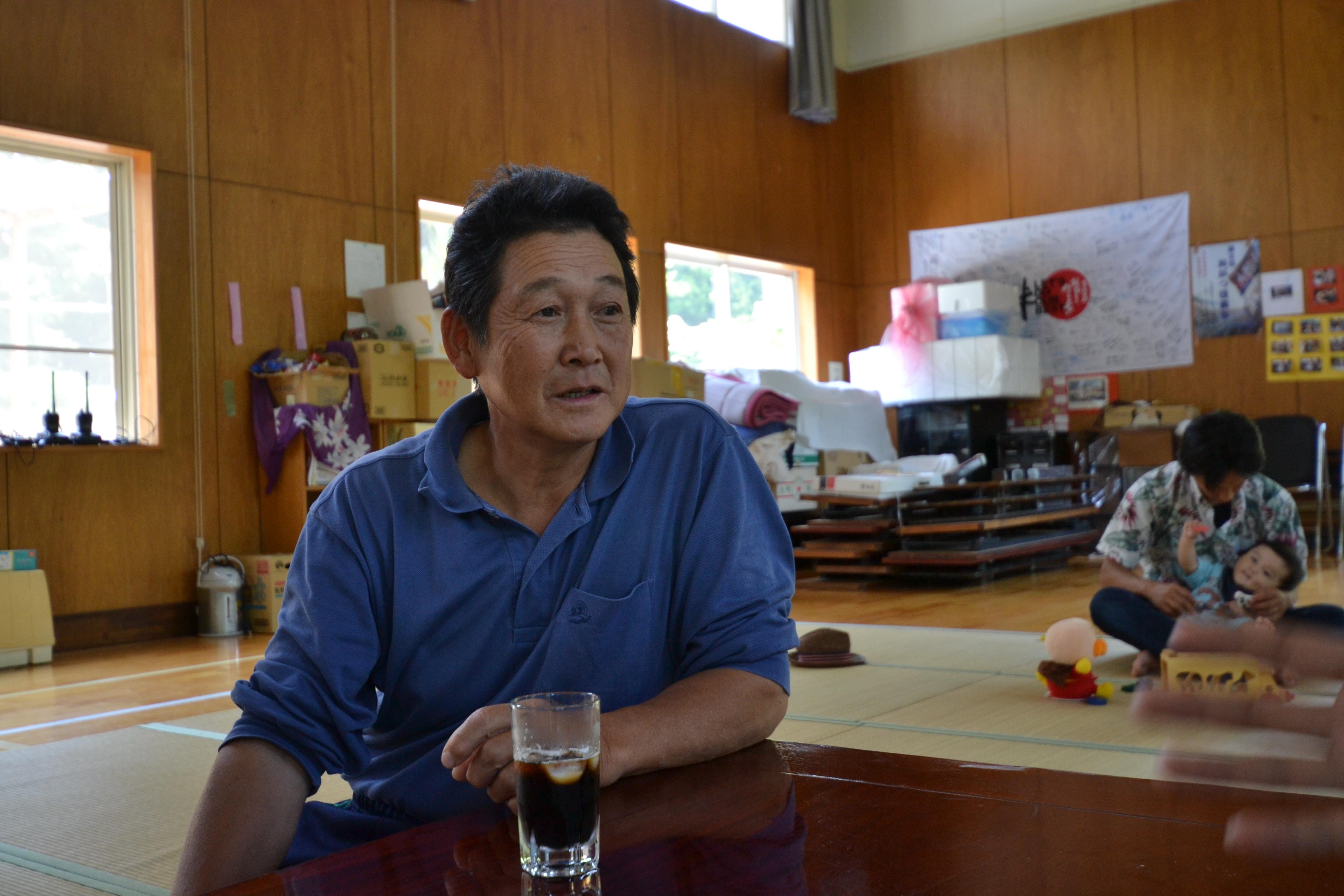 naburi yamato fisherman in temp emerg shelter meeting 2011.JPG