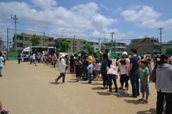 sendai emergency practise lineup for earthquake simulator.JPG