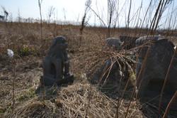 arahama statues in debris.JPG