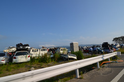 ishinomaki piled up cars in gareki.JPG