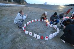 otuschi families candlelight march 11 memorial.JPG