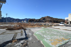 Onagawa town wiped out WIDE shows hillside and hospital.JPG
