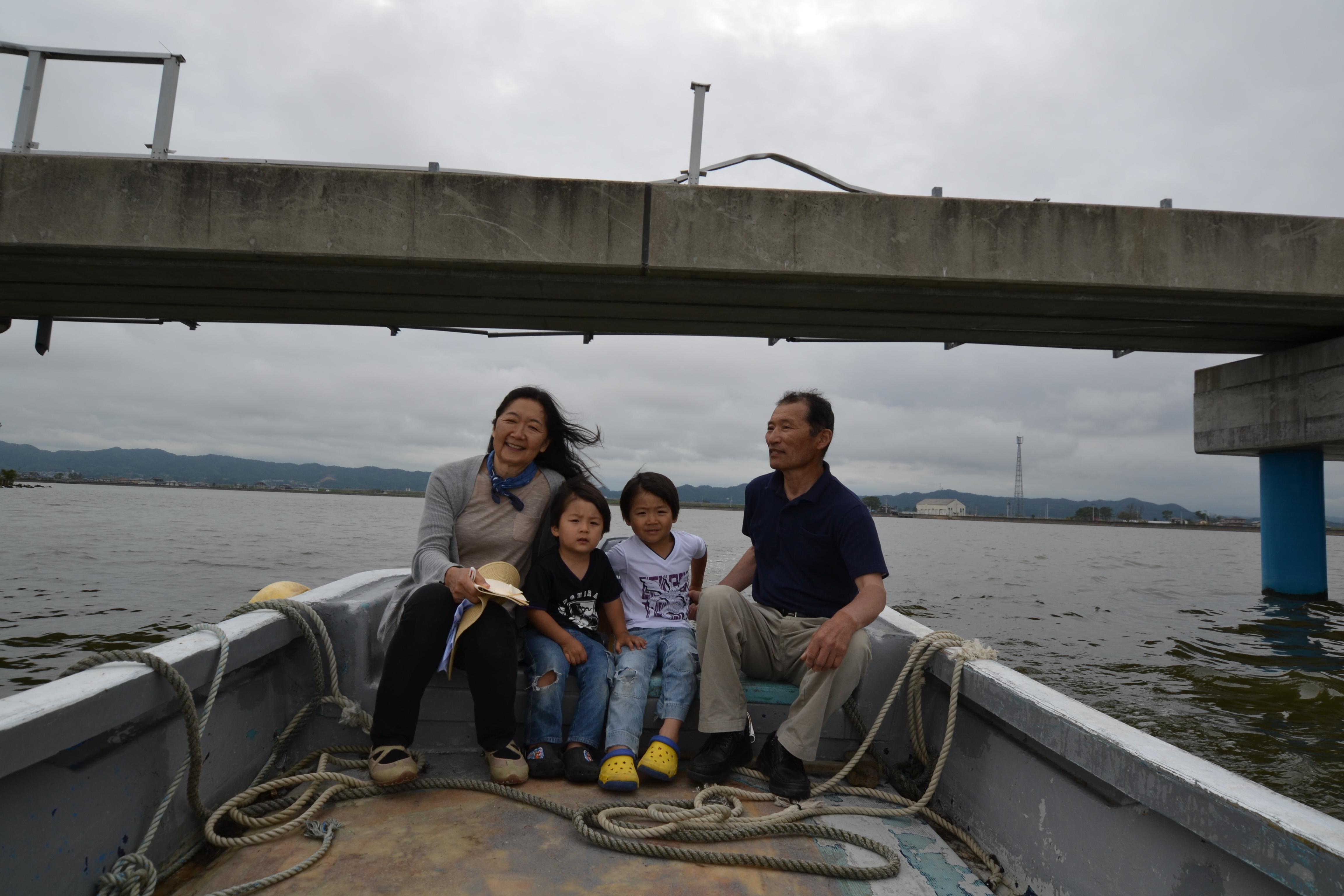 watari fisherman, linda, kuma kids check river.JPG