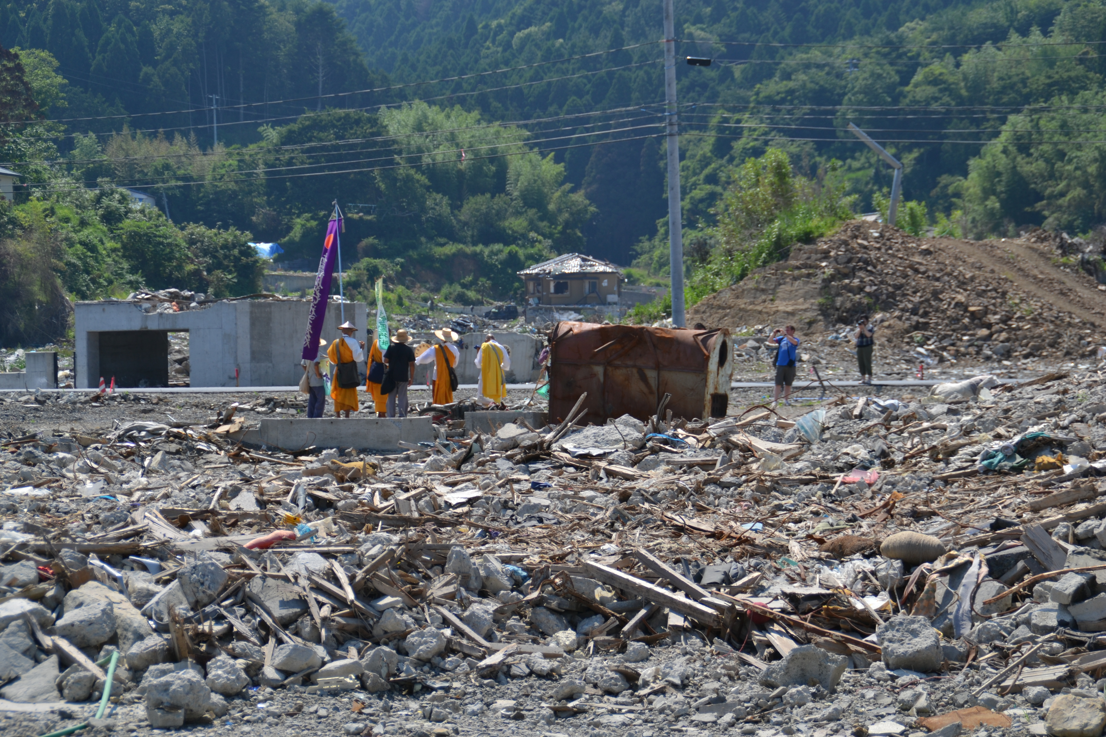 onagawa town flattened monks pray.JPG