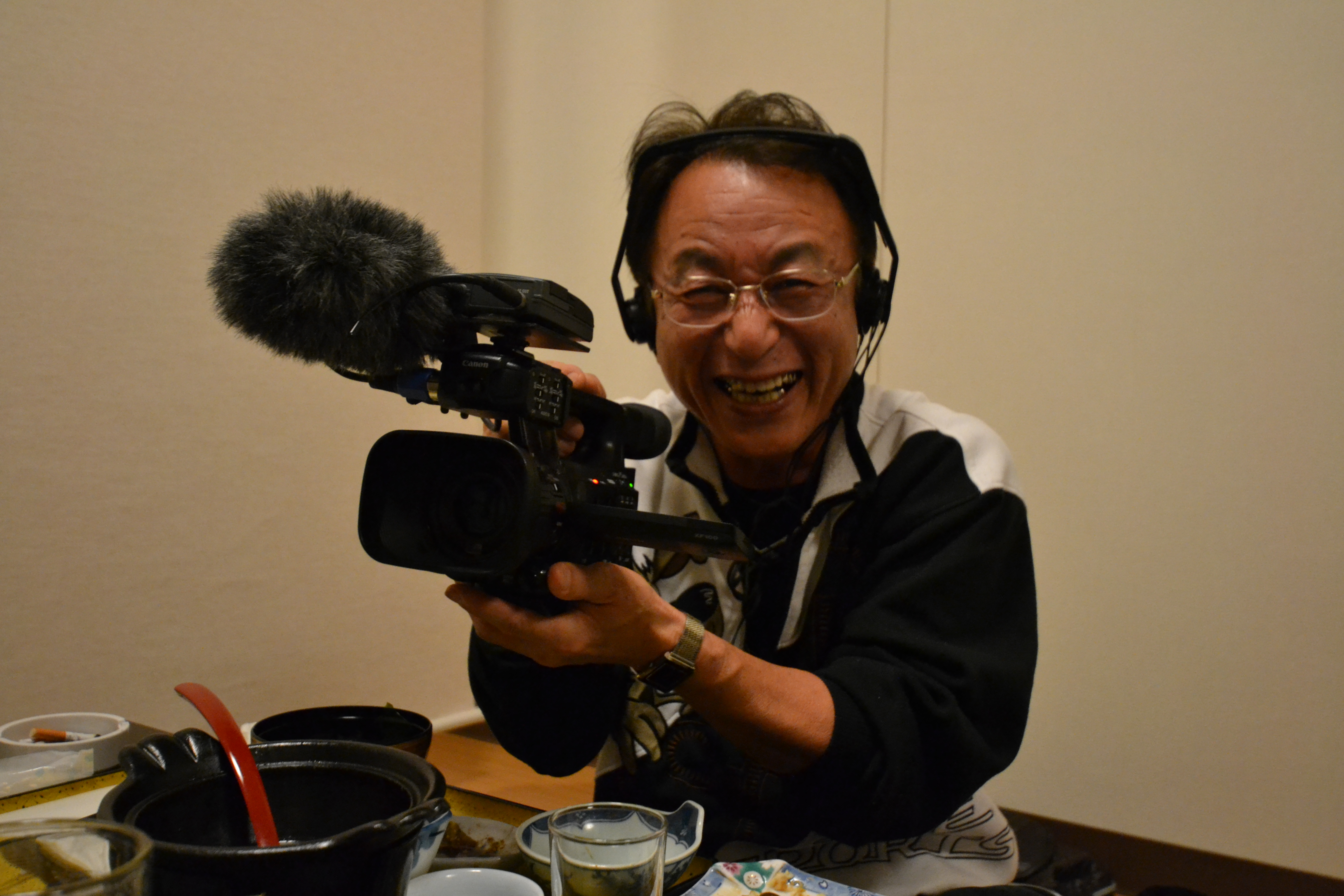 odaka kato barber holds camera.JPG