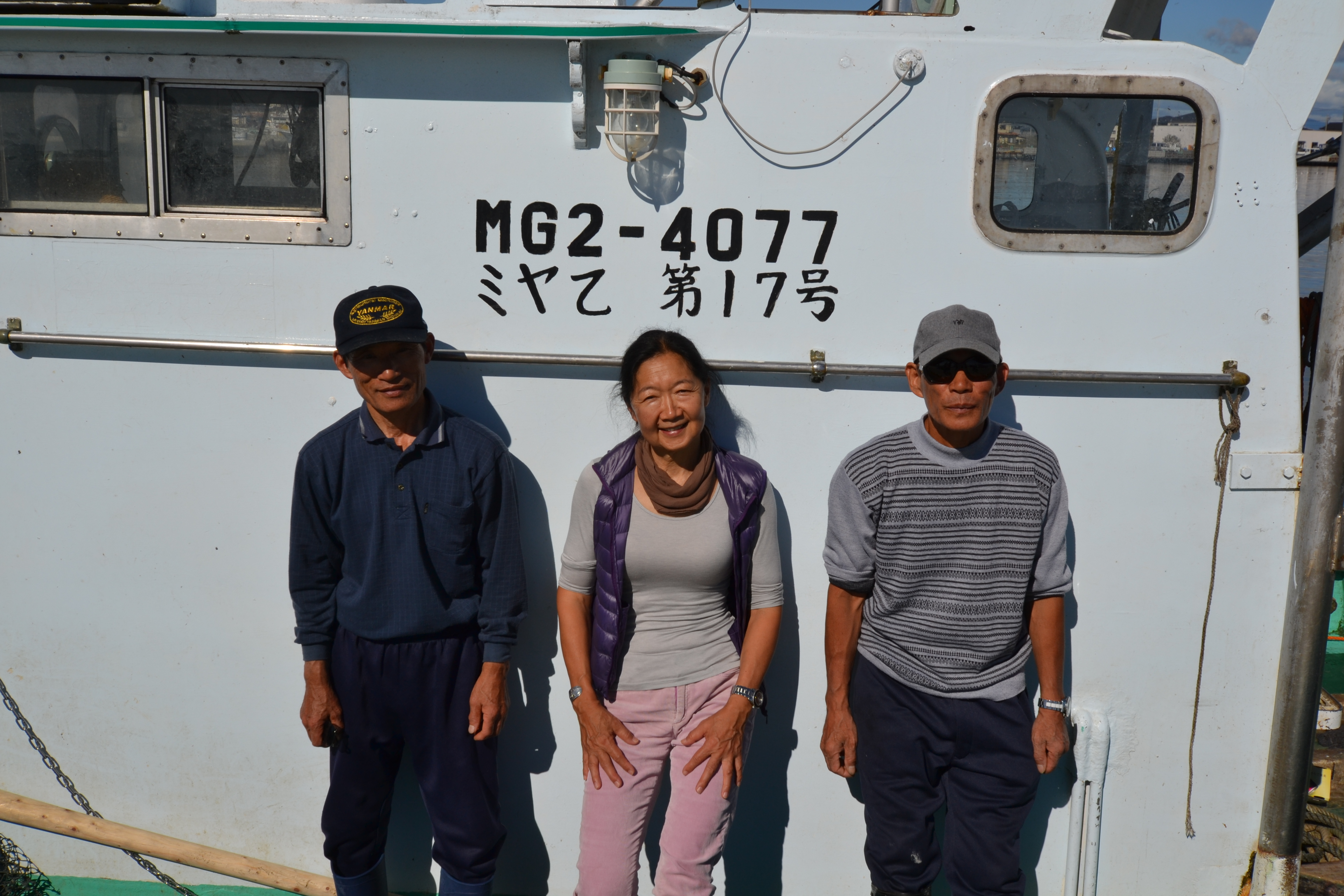 watari mori brothers on fishboat with linda.JPG