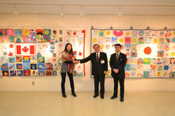 cloth letters onomichi exhibition linda with 2 school principals.JPG