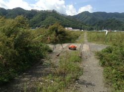 otsuchi filming town left in weeds train station 2016.JPG
