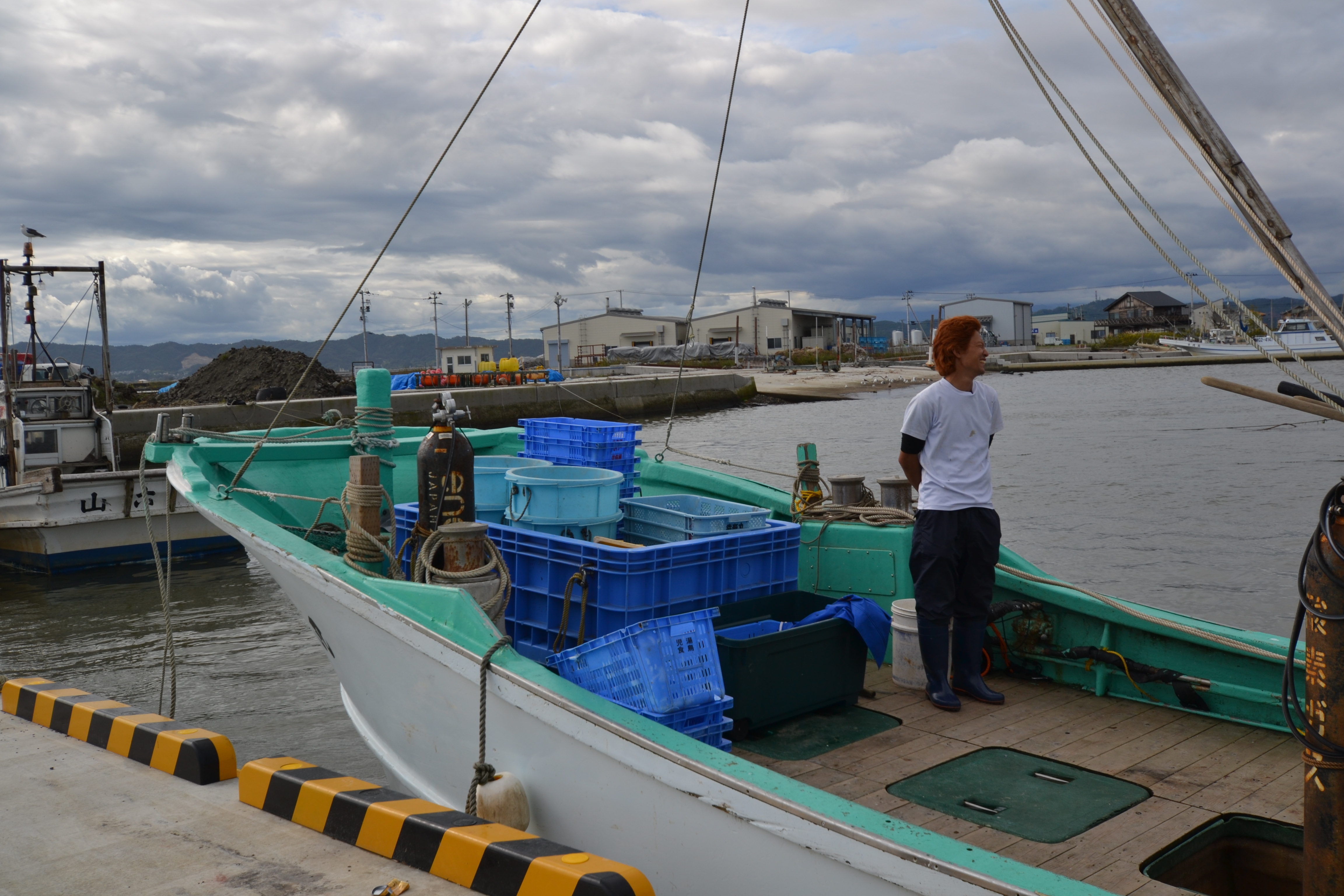 watari young mori fisherman on boat in harbor.JPG