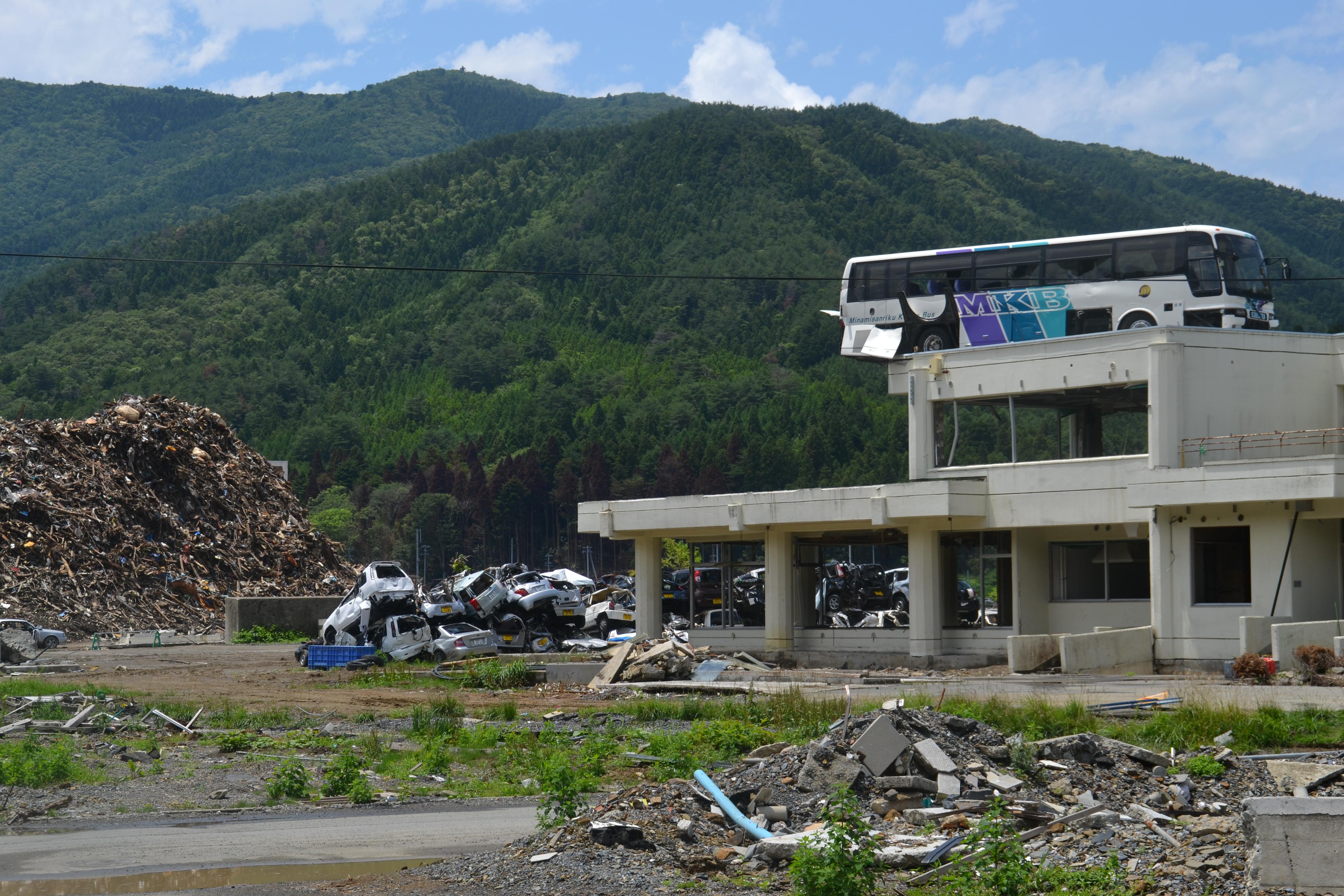onagawa bus on top of building rubble.JPG