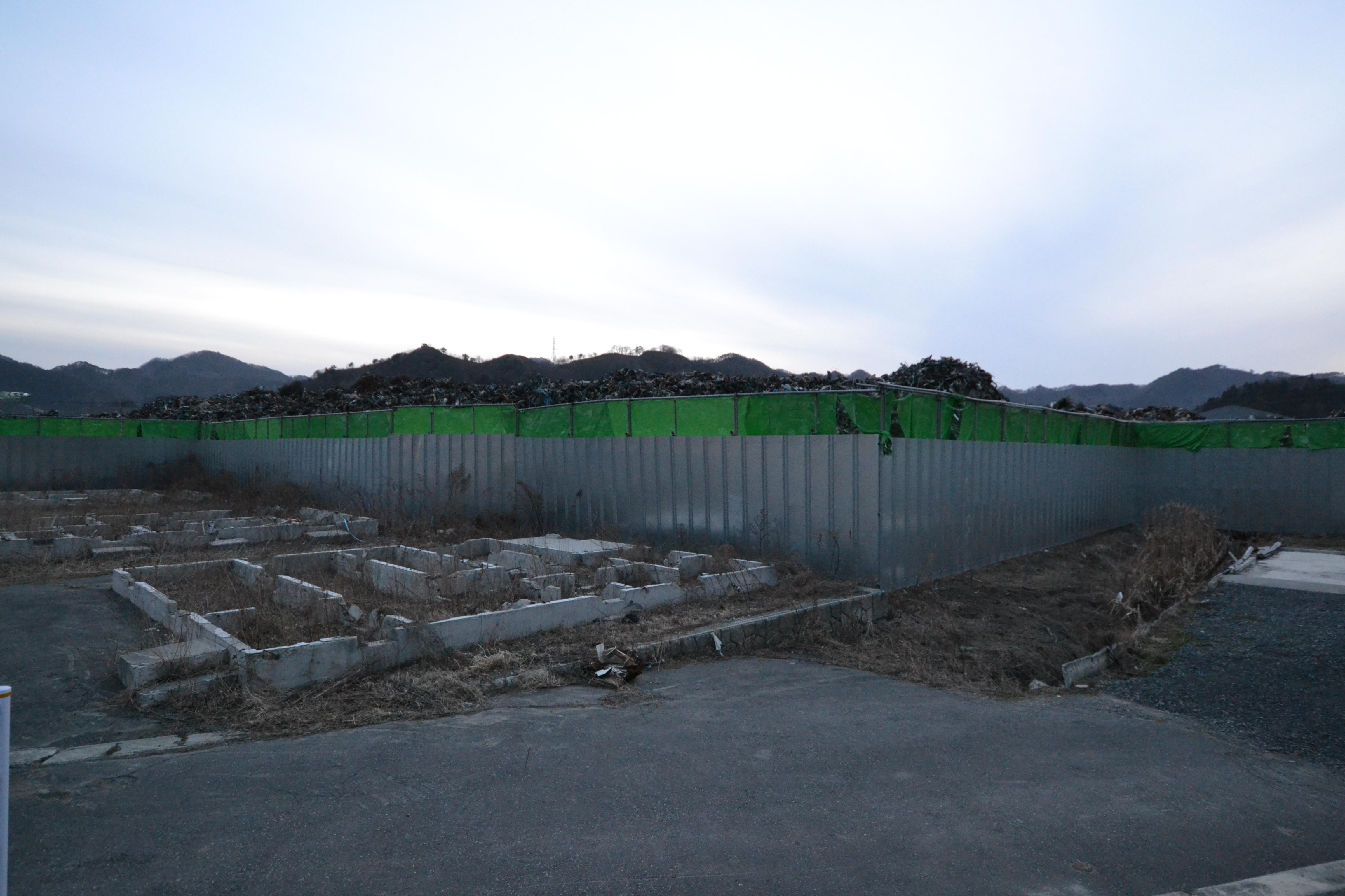 watari piles of debris and lost houses foundations.JPG