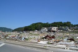 onagawa driving into town debris.JPG