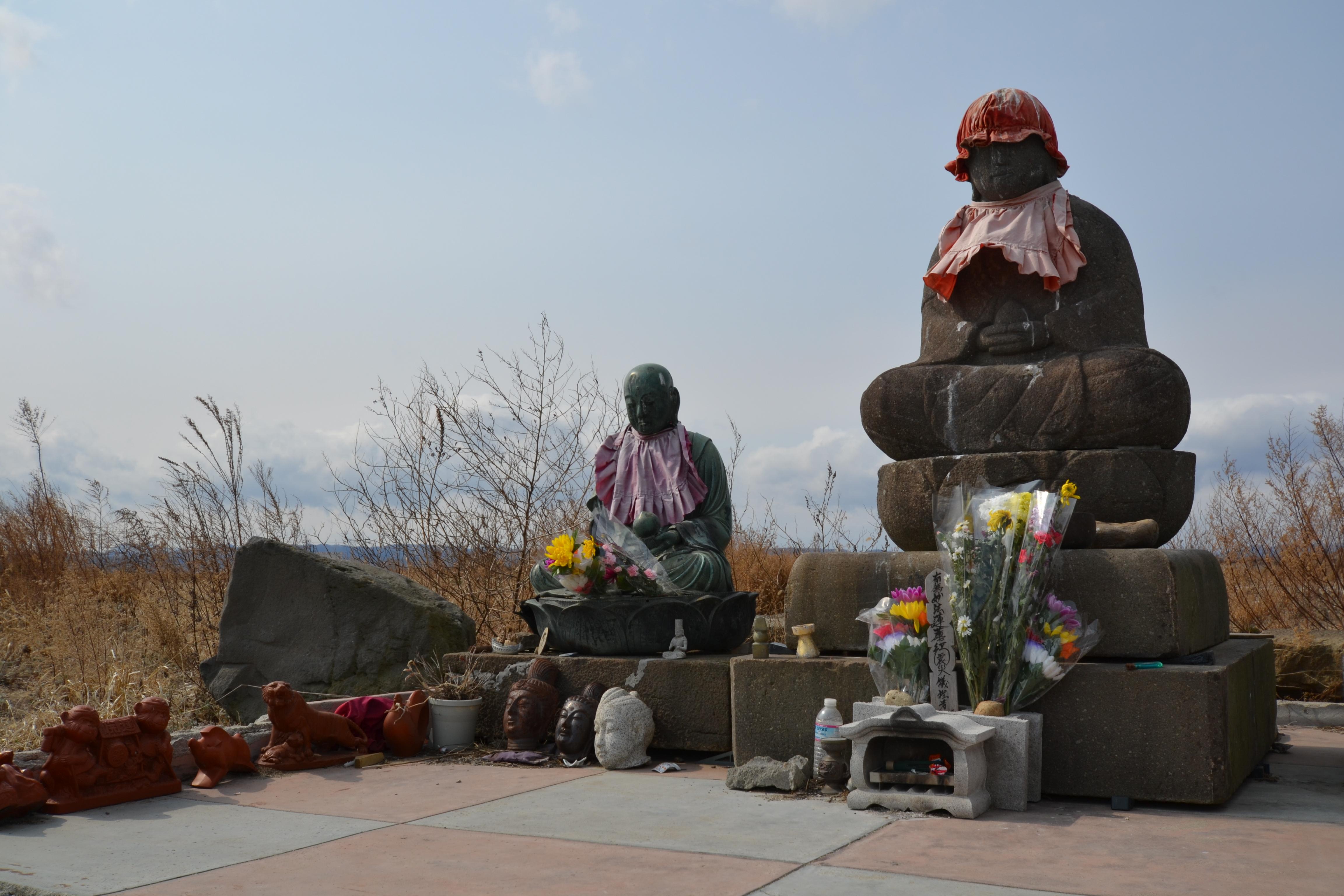 yuriage gone 2 statues for flowers prayers.JPG