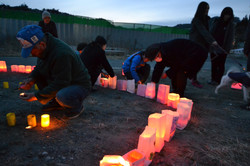 otsuchi survivors young and old light candles for memorial on March 11.JPG
