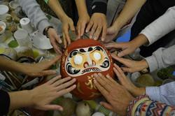 sendai daruma hands circle.JPG
