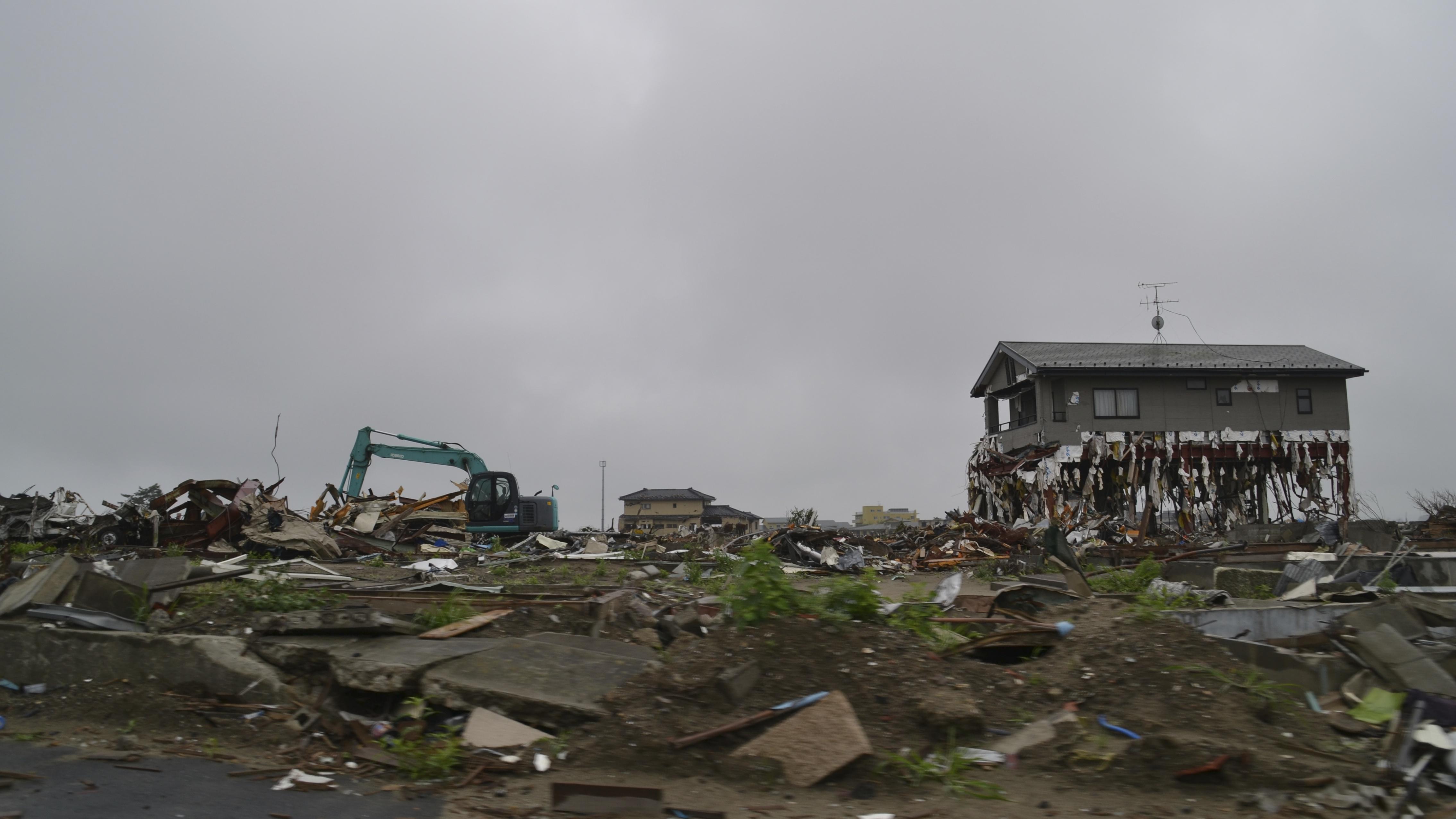 arahama tsunami through house debris.jpg
