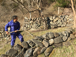 osuchi kanako husband cleans land.JPG