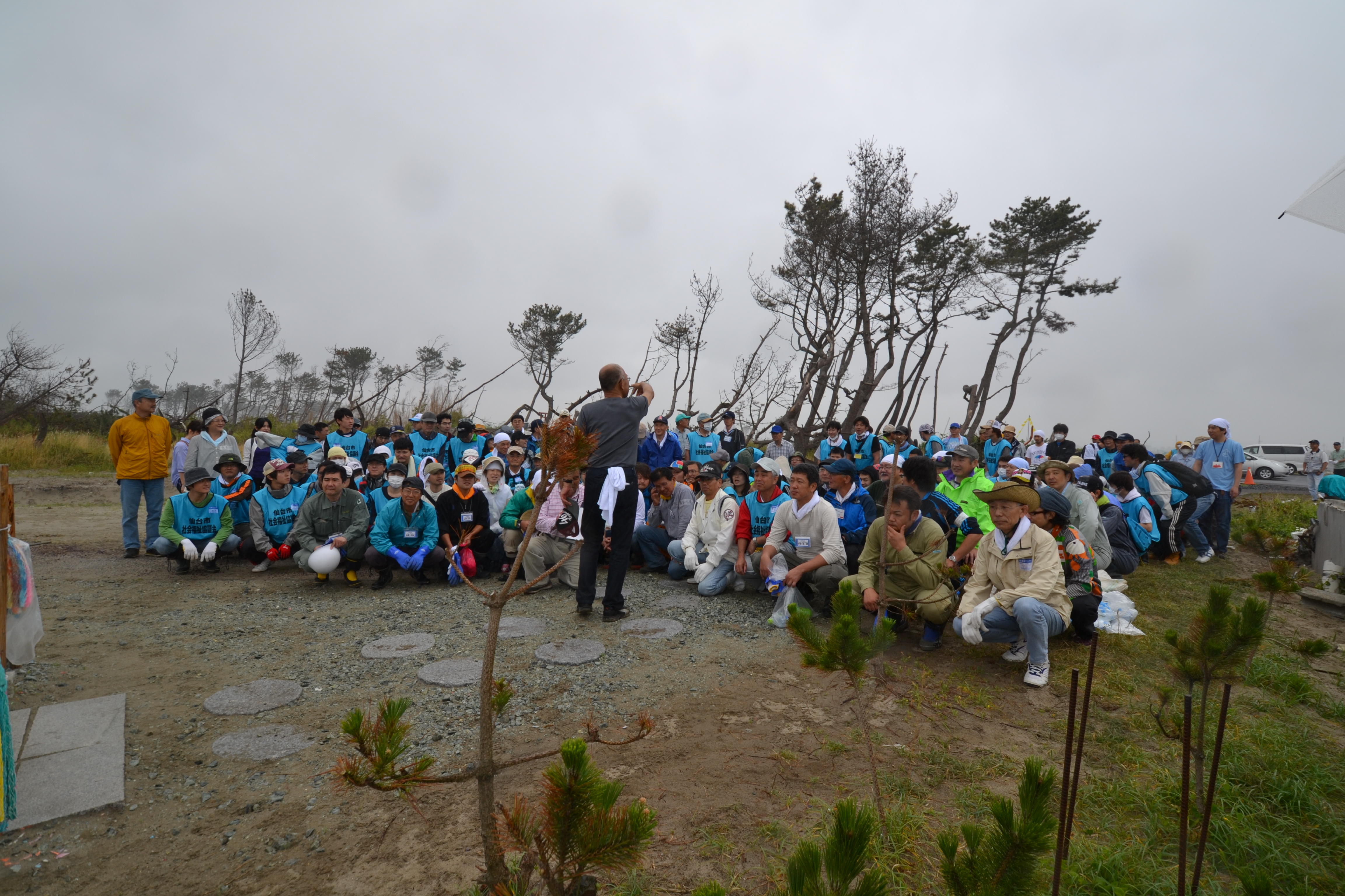 arahama survivors and volunteers return for community clean-up day.JPG