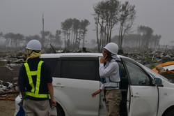 arahama debris officials on phone checkpoint 2011.JPG