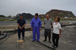 watari fishing families despair broken nets and mountain of debris.JPG