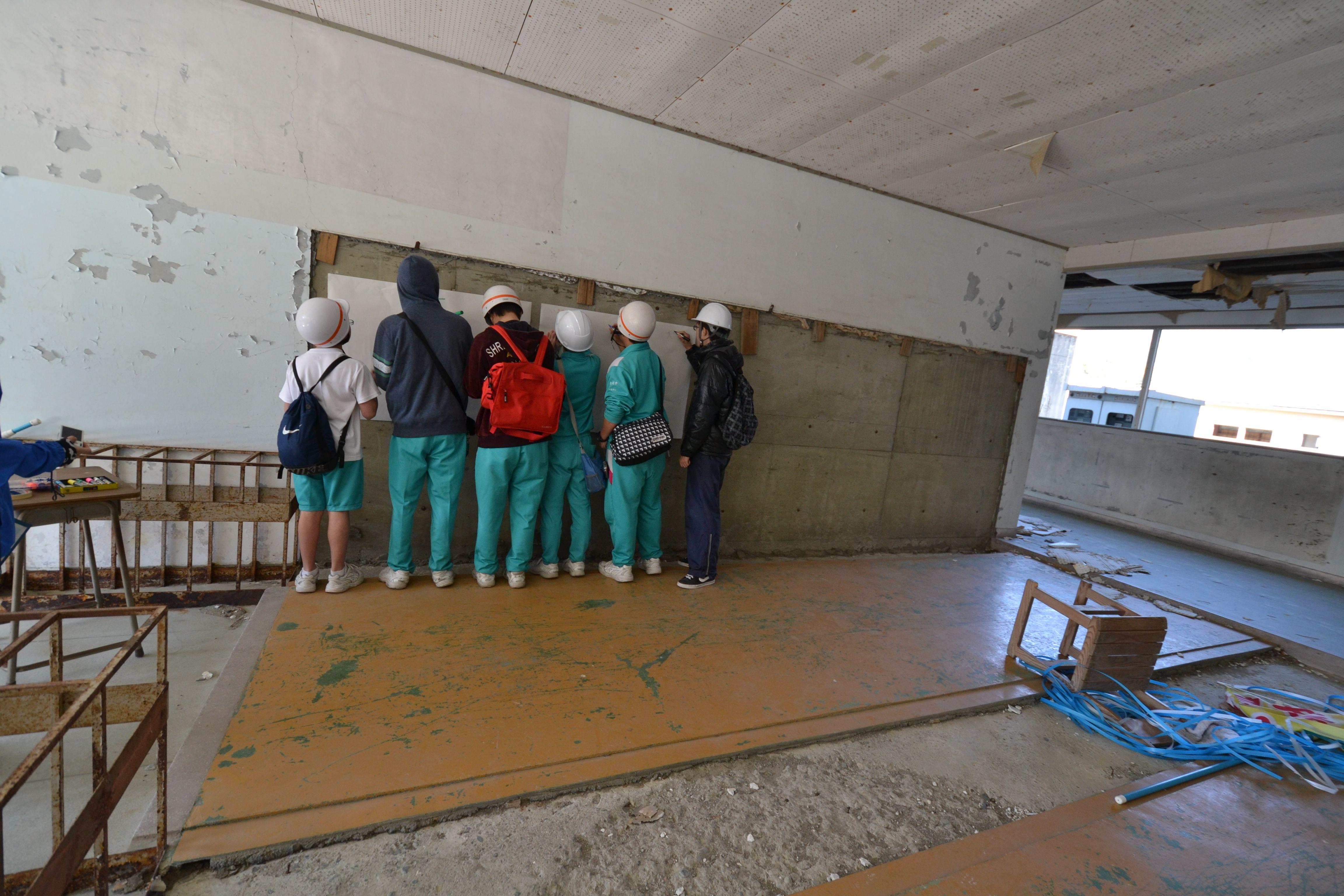 otsuchi students write messages on board destroyed school.jpg